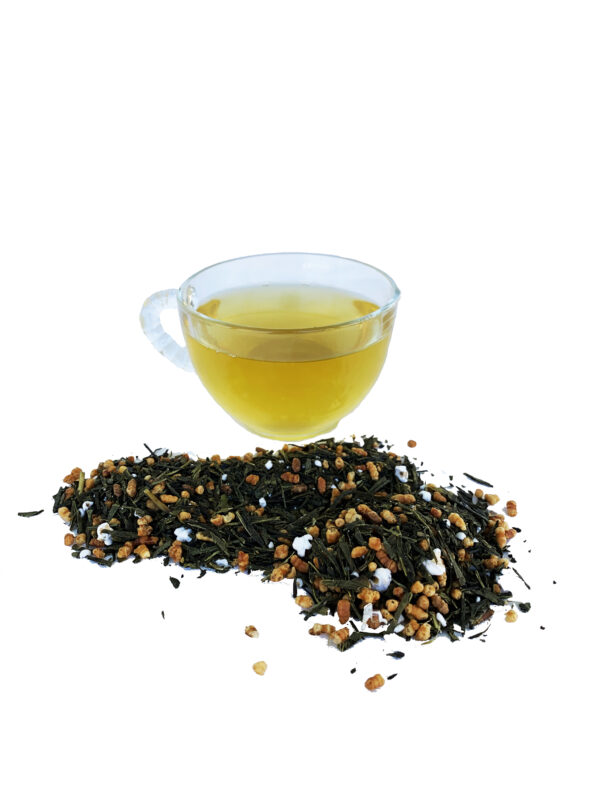 dry leaves of seven summit tea with brewed cup from front